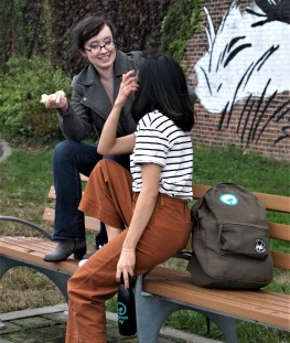 Fiona Conway and Janice Fong of Sprout Up NYC modeling merchandise: water bottle, iron-on patch, lip balm
